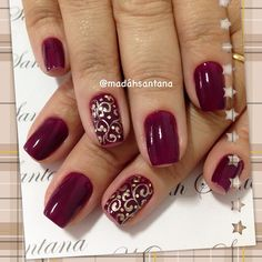 Red nails with gold filigree accent nail.