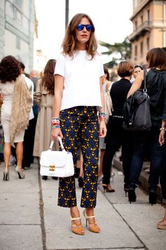 STREET STYLE SPRING 2013: MILAN FW - This woman lets statement pants stand out with all-white accoutrement.