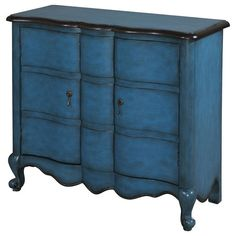 Two-drawer cabinet with a scalloped apron.   Product: CabinetConstruction Material: Solid wood and MDFColo...