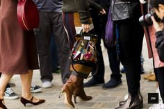 Streetstyle of Miroslava Duma wearing a Maison Martin Margiela bag during Paris Fashion Week Spring Summer 2017