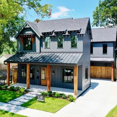 I love the exterior color. It really sets off that beautifully stained wood trim . 🤩 In case you are wondering, it's Mountain Home Exterior, Cottage Exterior, House Paint Exterior, Exterior House Colors, Dark Siding House, Dark House, Modern Farmhouse Design, Modern Farmhouse Exterior, Farmhouse Homes