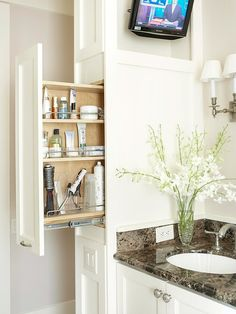 Use a Mini-Pantry cabinet in the bathroom for organized, easily accessible storage - - - VG