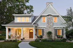 Reshaping the façade and retaining this home's existing stone provided proportion and beautifying balance. By Sicora Inc., St. Louis Park, MN.