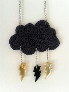 Spectacled Chicks. Crochet dark grey cloud made with cotton thread and stiffened to be used as a pendent. The adorable lightning bolts are made from acrylic and