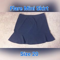 """Black Flare Mini Skirt 23"""" inches black ruffle mini skirt flattering with your favorite blouse or dress it up with a jacket add some fun with this chic skirt. 89% polyester / 11% spandex Context Woman  Skirts Mini"""