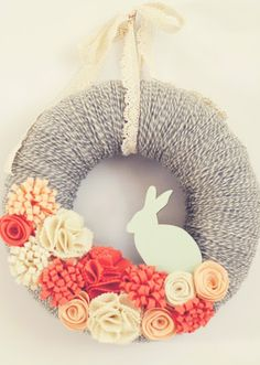 Gray and Coral Yarn To achieve this adoorable DIY, wrap a styrofoam donut in grey yarn, craft life-like flower out of felt and pop on a bunny for good measure.