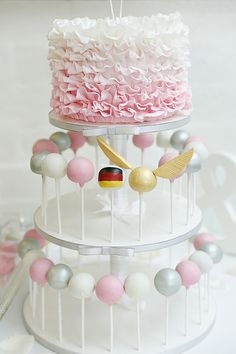 Ombre ruffle cake with cake pops... including golden snitch cake pop!