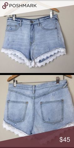 Free People lace trimmed denim short Fabulous lace trim on a distressed 5 pocket Jean short. 100% cotton Free People Shorts Jean Shorts