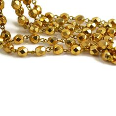 GOING GOLD|Beautiful hand-linked rosary chain featuring 6mm Czech Gold beads on Natural Brass links. These links can be gently opened and closed to customize length. Lead Free. Made in the Czech Republic.   [3ft-$21]