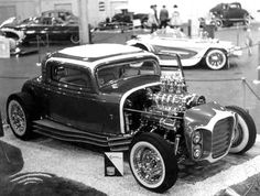 "Clarence ""Chili"" Catallo's incredible ""Silver Saphire"" coupe, also known as the ""Little Deuce Coupe"" on the Beach Boys album cover. The car, built by the Alexander Brothers in Detroit, is shown at an early 1960's car show with Ed ""Big Daddy"" Roth's ""Beatnik Bandit"" in the background."