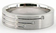 three diamonds lined up on a beautiful white gold or platinum band, in a design that works for both women and men