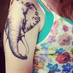 Elephant tattoo. Love the placement and size.
