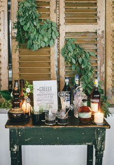 Great use for old shutters: backdrop for a bar. Tuck in eucalyptus leaves. --LYC