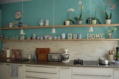 Turquoise kitchen with no upper cabinets