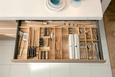 Kitchen Drawer Organization - Design Your Drawers So Everything Has A Place // This wide drawer holds all of the essentials, including daily cutlery, frequently used utensils and favorite spices, to make cooking and food prep that much easier.