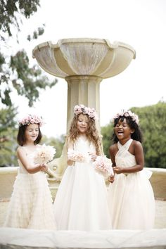 We adore these flower girl dresses and their pink flower garland crowns from Kirstie Kelly.