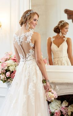 Stella York 6144 available at: Inspire Bridal Boutique St. Peter, MN 507-514-2224 inspirebridalboutique.com inspirebridalboutique@gmail.com