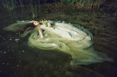 When down her weedy trophies and herself Fell in the weeping brook. Her clothes spread wide; And, mermaid-like, awhile they bore her up: Which time she chanted snatches of old tunes; As one incapable of her own distress, Or like a creature native and indued Unto that element: but long it could not be Till that her garments, heavy with their drink, Pull'd the poor wretch from her melodious lay To muddy death.