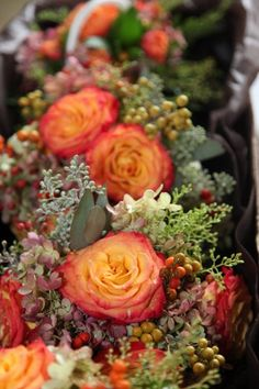 Brown Burgundy Orange Bouquet Fall Wedding ~ adding berries for texture is great in any fall bouquet.