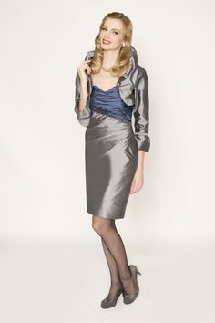 Marisa Baratelli 3387 / 5613-1 ruched cocktail dress and ruffle bolero in 506  Charcoal Silver and 496 Steel Blue.  http://www.marisabaratelli.com/collections/fall-classics-/cocktail.html?page=shop.product_details=vmj_color_plus_new.tpl_id=41_id=6