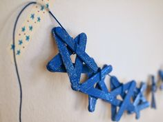Sparkly Ombre Popsicle Stick Star Garland (using Mod Podge)