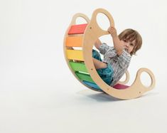 Rainbow Rocker - Every­one loves rain­bows, espe­cially when they're as fun and as well-designed as this wooden play­thing. Far more than a rocker, this mul­ti­func­tional, multi-colored beauty is suit­able for kids of all ages. It is made from birch ply­wood and can be used as a tun­nel, a stool, a toy cra­dle and even a lit­tle shop. Ingenious!