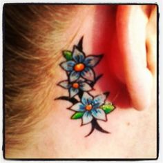 Blue flower tattoo :) behind the ear tattoo