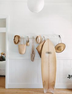 hat rack and surfboard photographed via @kawa_heart_studio on instagram. / sfgirlbybay
