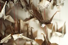 Sarah Pinyan posted diy paper butterfly ornaments or tags from old book pages to her -Papercraft- postboard via the Juxtapost bookmarklet. Origami Garland, Origami Stars, Origami Cranes, Oragami, Origami Paper, Diy Paper, Paper Crafts, Vellum Paper, Paper Art