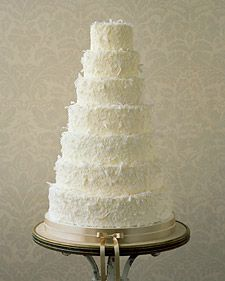 Dreamy and delicate, these coconut-flavored wedding cakes are whimsical and beautiful with a flavor that is oh so recognizable.