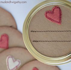 Heavy kraft paper jar tops sewn by machine with tiny, freehand wool felt embellishments & two lines of little stitches