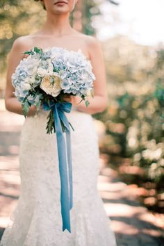 blue hydrangea and white garden rose bouquet tied with a blue ribbon by PEONY Art Decoration Studio