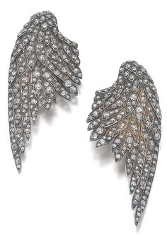 A pair of diamond clips, early 20th century. The clips in the form of wings set with cushion-shaped, circular-, single-cut and rose diamonds. #vintage #EarClips