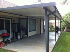 Pictured below is an 11′ x 36′ Aluminum patio cover with three fan beams in the roof panels.