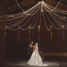 A rustic barn wedding on New Years Eve with fabulous country theme including hay…