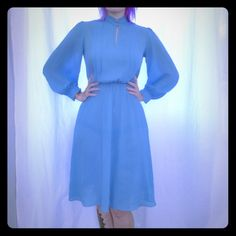 Light blue authentic vintage dress Iightweight, absolutely adorable! Buttons on ends of sleeves for the perfect touch of detail. Dresses