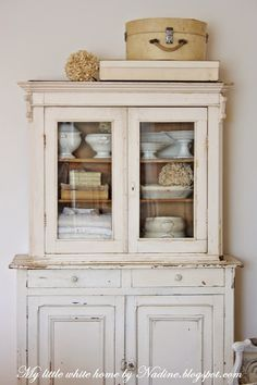 Love the color of this cupboard and the ironstone pieces