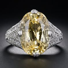 A bright and sunshiny, natural lemony-yellow oval sapphire, weighing an ample carats, glistens and glows from atop a newly-made, vintage-style platinum and diamond mounting. The mounting is artfully designed in timeless Edwardian style to optimally Sapphire Jewelry, Diamond Jewelry, Sapphire Diamond, Gemstone Engagement Rings, Gemstone Rings, Perfume, Antique Jewelry, Vintage Jewelry, Rose Gold Morganite Ring