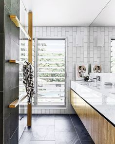 In a flood-prone area of suburban Brisbane, a post-war cottage was extended into a contemporary and colourful split-level family home by architect Shaun Lockyer. Ceramic Tile Floor Bathroom, Louvre Windows, White Wall Tiles, Slate Tiles, Rustic Home Design, Modern Tiny House, Sliding Glass Door, Sliding Windows, Sliding Doors