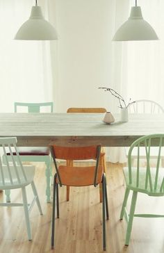 dining room: barn pendant, wood table with grey stain, soft green chairs. I love this.
