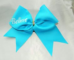 This bow measures 9.5 inches wide and 7.5 inches tall with a ribbon width of 3 inches. All ends have been heat sealed for fraying resistance. The bow is attached to a black pony tail holder.