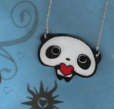 Panda necklace. I wonder if you could make it with shrink plastic....