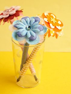 Quick and Easy Floral Pens:  Brighten someone's day with super-easy spring-theme pens. Secure flower embellishments atop a pen, then wrap the base with coordinating paper for a pretty, put-together look.