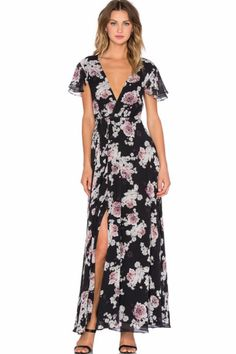 Inspired by the need for luxe bohemian pieces for the modern nomad's wardrobe. The JETSET DIARIES is a contemporary collection influenced by women who capture the free loving spirit of the modern bohemian creating pieces for the quintessential jet-setter wardrobe. -Hand wash cold--Fully lined--Wrap front with tie closure--Ruffle sleeves--Lace-up back Rosa-Floral Maxi Dress by The JetSet Diaries. Clothing - Dresses California