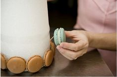 use toothpicks - toothpick into the styrofoam tower then place the macaron on.