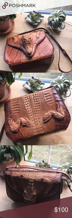 Vintage Cuban Alligator Purse Vintage Cuban Genuine Alligator Purse (1950s) Perfect condition. Full alligator wrapped around bag: head, tail, feet. Glass eyes. Interior zip pocket. Vintage Bags