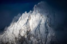 """There is no #light like post-winter-storm-snow-plastered-mountains light.  The South Face of Aiguille du Tour yesterday afternoon during a brief clearing in the #snowstorm. The famous """"table"""" rock precariously balanced on the #ridge is visible near the main sub-summit. #Chamonix #mountain #aiguilledutour #winter #winterlight #NikonFR #D810 #aerial by alexbuisse"""
