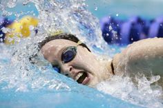 Snider's Georgia Baldus takes a breath as she swims in the fourth and fastest 200-yard freestyle heat race during the preliminaries of the girls swimming and diving state meet on Feb. 8 at the IUPUI Natatorium.