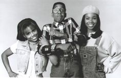 Steve Urkel seen with both of his girlfriends on Family Matters.  Myra Monkhouse to the left and Laura Winslow to the right.