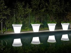 Rotoluxe's illuminated planters use low-watt CFL/LED lighting to give off a warm, ambient glow. The lightweight containers are impact resistant and made in the USA from 100 percent recycled plastics.